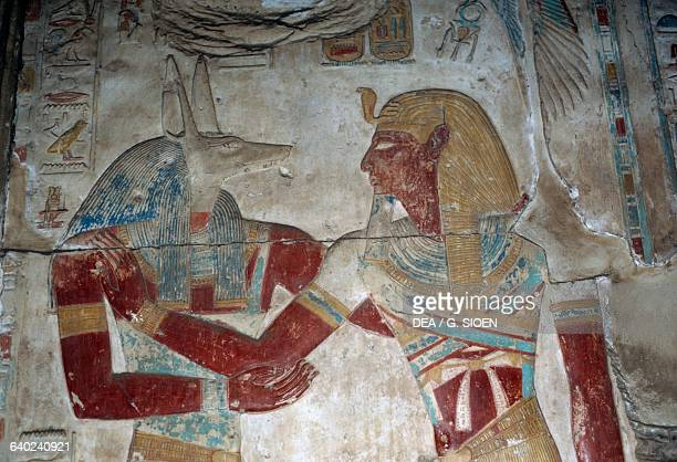 Painted relief depicting the Pharaoh and god Anubis chapel of Osiris Temple of Seti I 13061290 bC Abydos Egypt Egyptian civilisation New Kingdom...