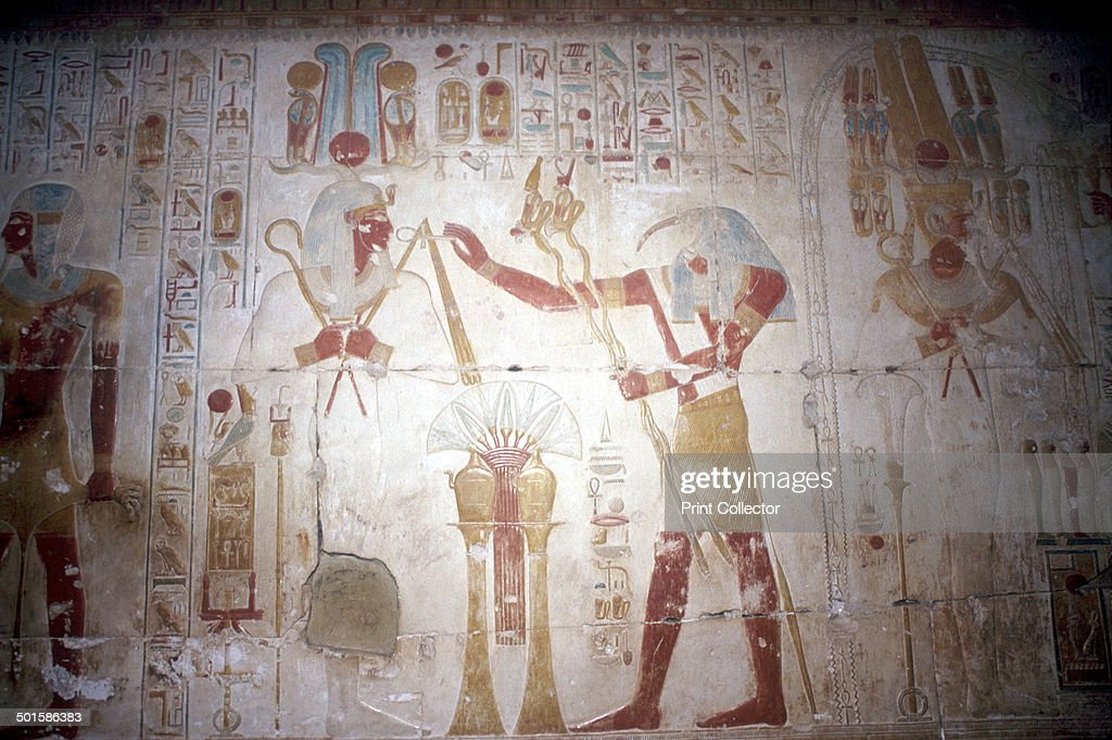 Painted relief of the Pharaoh before Thoth (Ibis-headed god), Temple of Sethos I, Egypt, c1280 BC. : News Photo