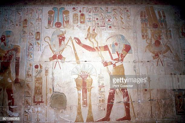Painted relief of the Pharaoh before Thoth Temple of Sethos I Abydos Egypt 19th Dynasty c1280 BC The Pharaoh before Thoth receiving the Ankh symbol...
