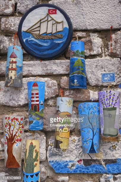 painted roof tiles sold as souvenirs,ildır. - emreturanphoto stock pictures, royalty-free photos & images