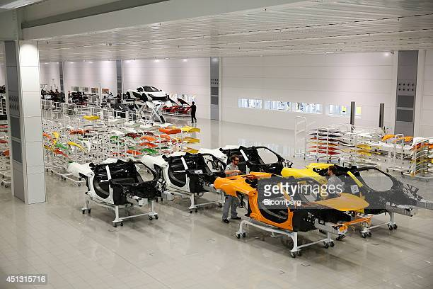 Painted sections of McLaren luxury automobiles sit on trolleys ahead of assembly at McLaren Automotive Ltd's plant in Woking UK on Friday June 27...