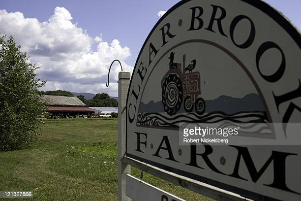 Painted sign hangs at the front of the Clear Brook Organic Farm August 4, 2011 in Shaftsbury, Vermont. The 200-plus acre farm was started in 1995 by...