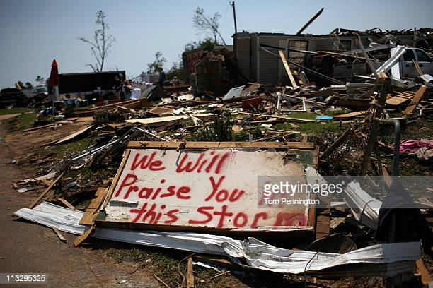 Painted sign sits outside destroyed homes on April 30, 2011 in Tuscaloosa, Alabama. Alabama, the hardest-hit of six states, is reported to have had...