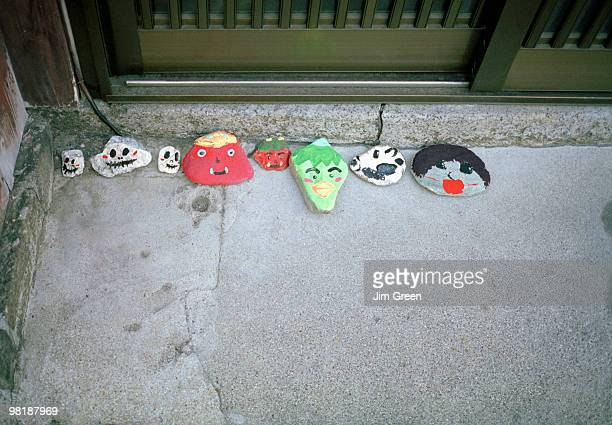 Painted stones on a door step