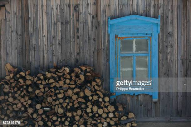 Painted window of a wooden house on the northwestern bank of Lake Baikal