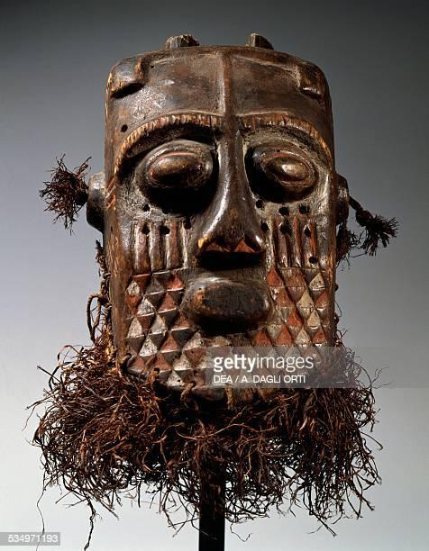 Painted wooden mask with stalks of straw Bakuba or Kuba people Democratic Republic of the Congo 20th century