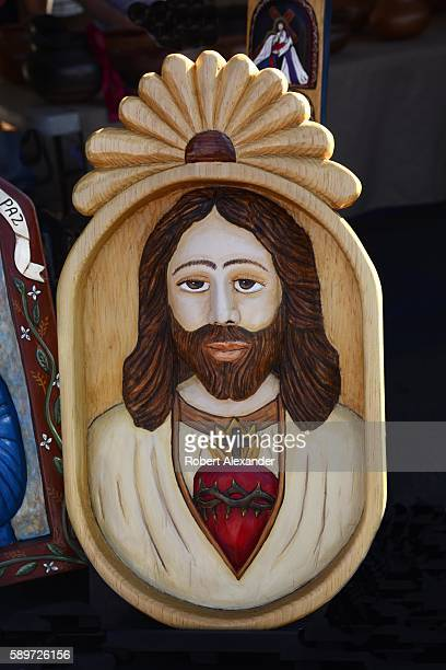 Painted wooden relief panel depicting Jesus by Hispanic artist Ronald Martinez is among the artworks at the Spanish Market on July 30, 2016 in Santa...