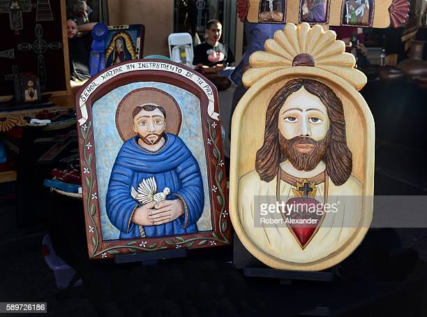 Painted wooden relief panels by Hispanic artist Ronald Martinez are among the artworks at the Spanish Market on July 30, 2016 in Santa Fe, New...