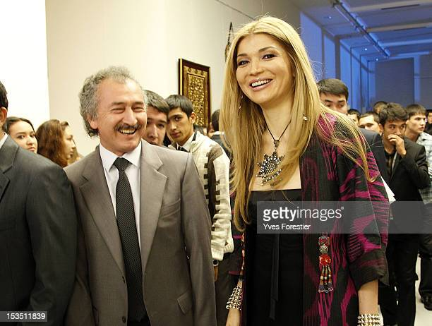 Painter Akmal Nur and Gulnara Karimova Chairwoman of the Fund Forum Board of Trustees visit the exhibition during the StyleUz Art Week 2012 opening...