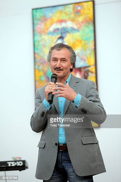 Painter Akmal Nur makes a speech during the Akmal Nur Exhibition opening at The Center of National Arts on October 13 2009 in Tashkent Uzbekistan
