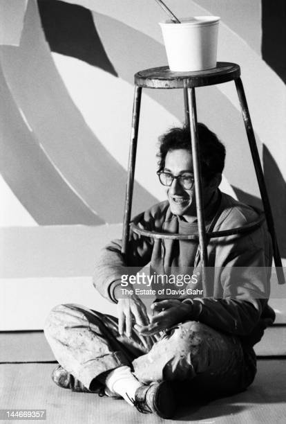 Painter and printmaker Frank Stella poses for a fun portrait on November 15 1967 in his studio in New York City New York