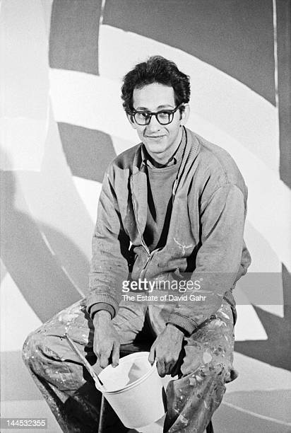 Painter and printmaker Frank Stella poses for a portrait on November 15 1967 in his studio in New York City New York