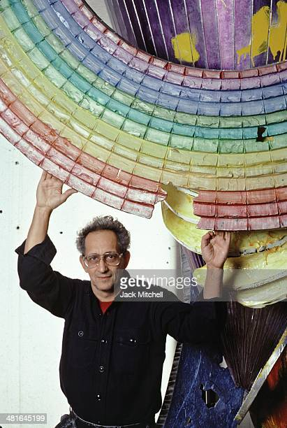 Painter and printmaker Frank Stella with his work in his New York studio in 1987