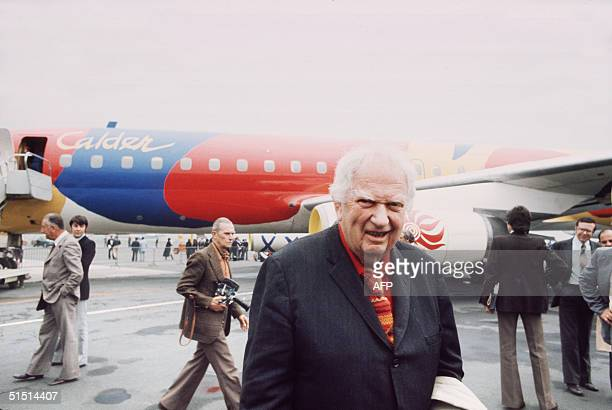US painter and sculptor Alexander Calder smiles in front of a Braniff jetliner which he painted 29 May 1975 during le Bourget International Air Show...