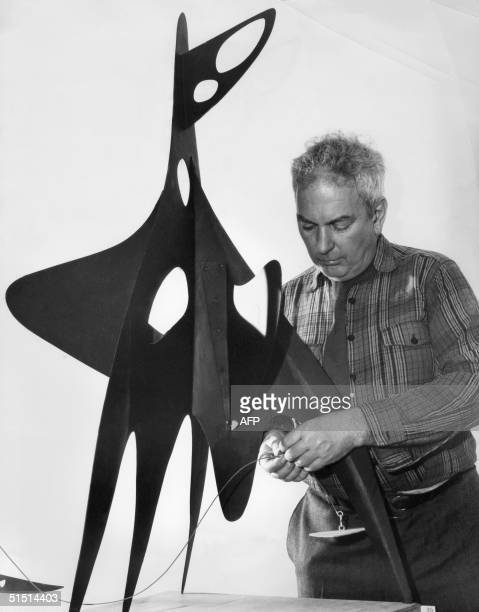 US painter and sculptor Alexander Calder works in September 1948 in a New York gallery on one of his stabiles The stabile shown here could be ano one...