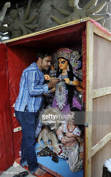 Painter and sculptor Pradip Rudra Pal is giving the finishing touch to a Fibre Glass Durga idol which is to be sent to Denmark at his studio at...