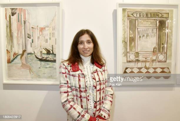 Painter Anna Peter-Breton poses with her work during Voyage amoureux en Italie Anna Peter-Breton Preview on Galerie Sarto on March 4, 2021 in Paris,...