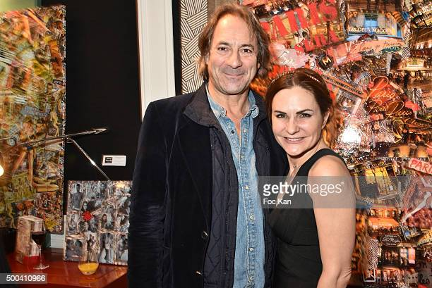 Painter Anne Mondy and writer Alain Teulie attend the 'Accords Croises' Anne Mondy Exhibition Preview at Galerie Dedar on December 7 2015 in Paris...
