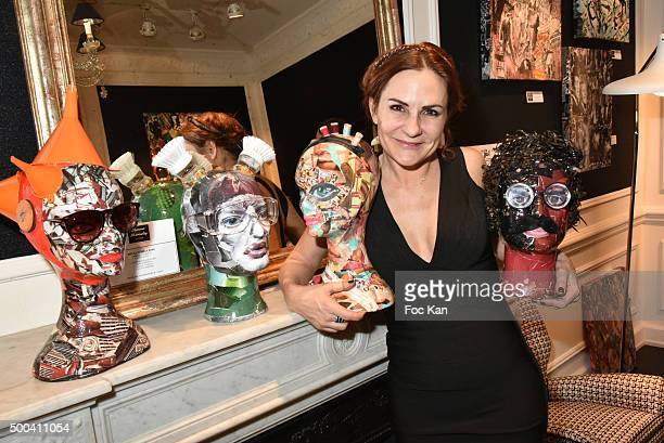 Painter Anne Mondy poses with her work during the 'Accords Croises' Anne Mondy Exhibition Preview at Galerie Dedar on December 7 2015 in Paris France