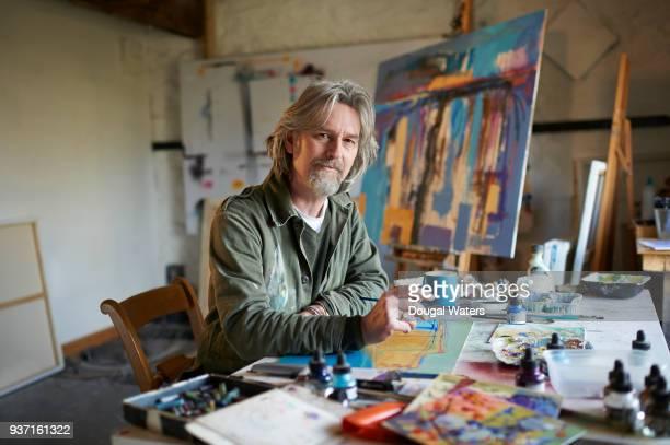 Painter artist in studio.