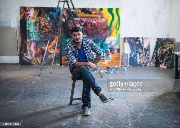 painter artist portrait in studio. - art studio stock pictures, royalty-free photos & images