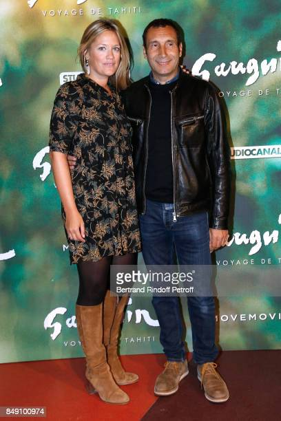 Painter Caroline Faindt and her companion actor Zinedine Soualem attend the 'Gauguin Voyage de Tahiti' Paris Premiere at Cinema Gaumont Capucine on...