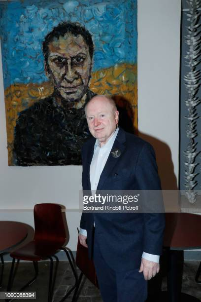 Painter Christoph von Weyhe poses in front of a portrait of Azzedine Alaia by Julian Schnabel during Alaia Foundation Library Opening at Gallery...