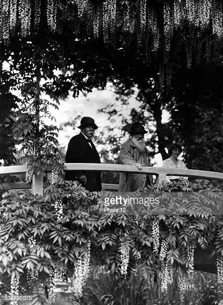 Painter Claude Monet and Clemenceau on the waterlilies bridge at Giverny