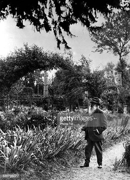 Painter Claude Monet in his garden