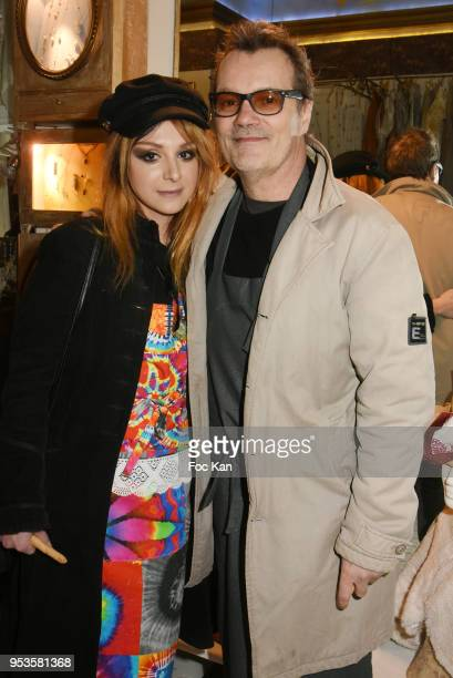 Painter Erica and Singer Axel Bauer attend Zelia Van Den Bulke Aprons show At Zelia Abbesses Shop on May 1, 2018 in Paris, France.