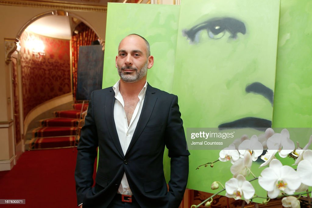 Painter Giovanni Perrone poses with his work during the exhibition of artwork featuring Giovanni Perrone and hosted by Ivana Trump and Mark Antonio Rota on April 30, 2013 in New York City.
