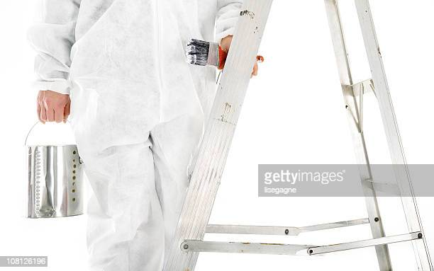 Painter Holding Paint Can on Ladder