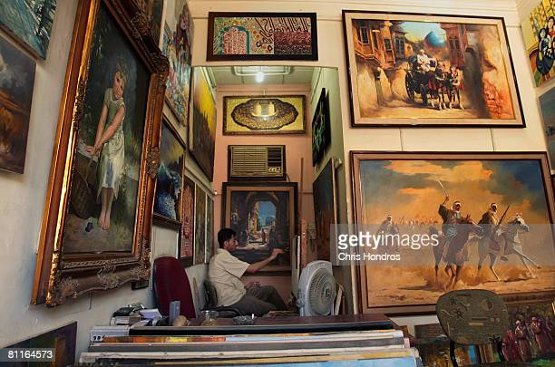 Painter Hussein al Musawi works in his studio in the alAsfar artist's district May 20 2008 in Baghdad Iraq AlAsfar is Baghdad's main district for...