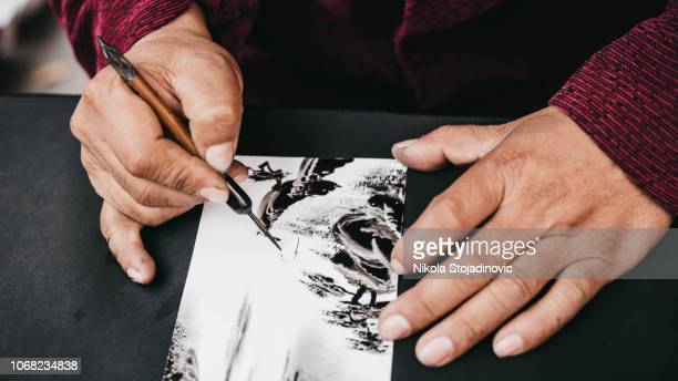 painter in china - street artist stock photos and pictures