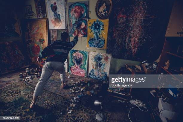 painter in studio - south_agency stock pictures, royalty-free photos & images