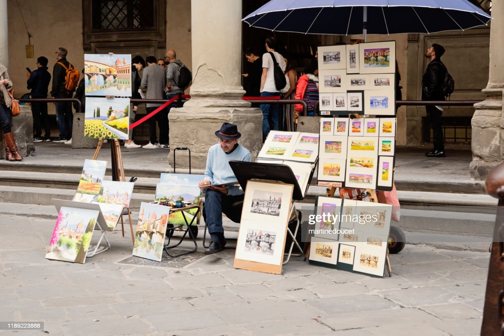 Painter in the piazza of the Uffizy Gallery, Florence Italy : Stock Photo