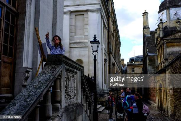 A painter is seen at work in Cambridge on August 25 2018 Cambridge is home to the worldrenowned University of Cambridge which was founded in 1209 The...