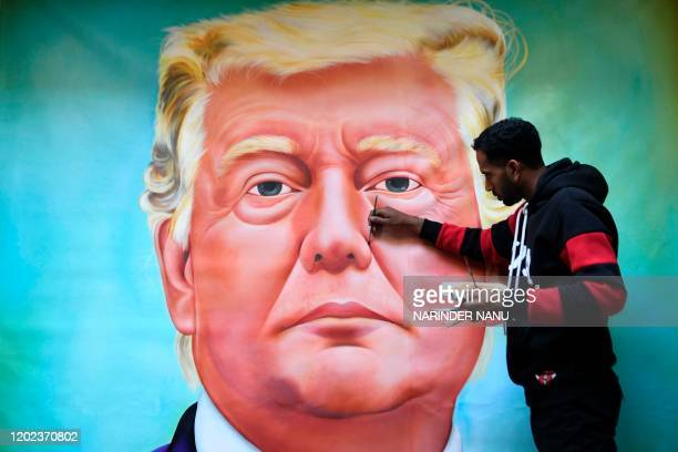 Painter Jagjot Singh Rubal gives final touches to a painting depicting US President Donald Trump in Amritsar on February 22 2020 Donald Trump and his...