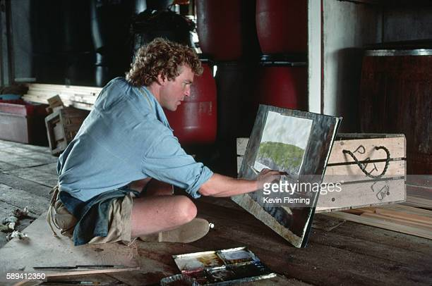 Painter Jamie Wyeth son of painter Andrew Wyeth works on a painting while sitting on the floor