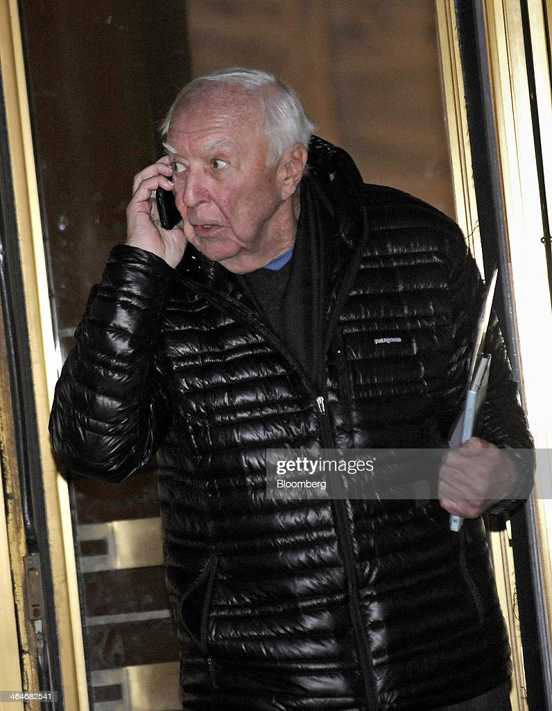 Painter Jasper Johns talks on a cell phone while exiting federal court in New York, U.S., on Thursday, Jan. 23, 2014. Johns testified against foundry owner Brian Ramnarine charged with trying to sell a fake bronze sculpture of his 1960 painting 'Flag' for $11 million. Photographer: Louis Lanzano/Bloomberg via Getty Images
