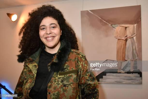 Painter Johanna Tordjman poses with her work during Wall de Femmes Collective Women Art Exhibition Preview As part of Journee des Droits des Femmes...