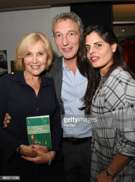 Painter Lee Michel her husband Olivier Michel and TV Meteo presenter Fabienne Amiach attend Olivier Michel Private Dinner Party at Sens Uniques...
