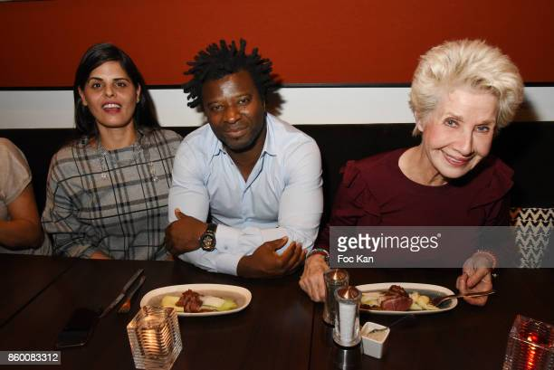 Painter Lee Michel rap artist Rost and former TV presenter Daniele Gilbert attend Olivier Michel Private Dinner Party at Sens Uniques Restaurant on...