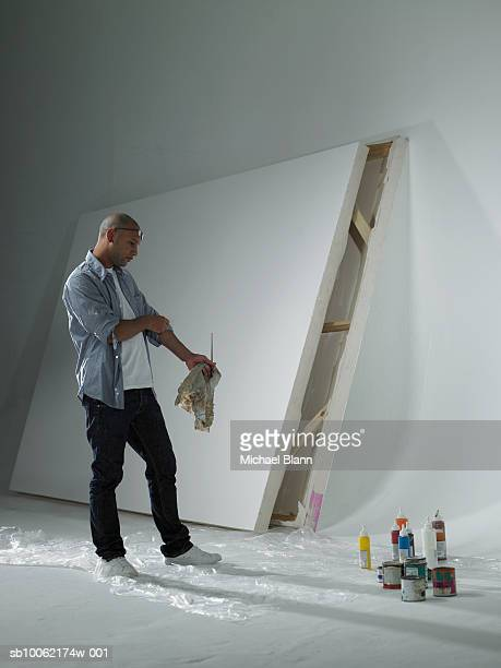 Painter looking at materials