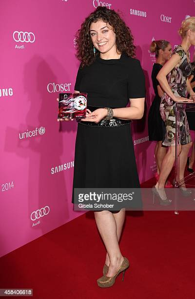 Painter Nahid Shahalimi with from her created samsung handy attends the CLOSER Magazin Hosts SMILE Award 2014 at Hotel Vier Jahreszeiten on November...