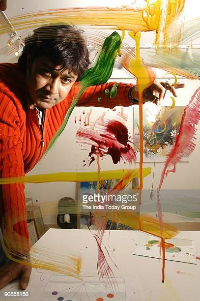 Painter Niladri Paul displays the process of colour therapy using a pendulum in New Delhi India