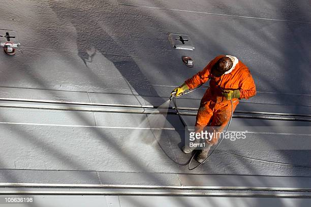 painter - dock worker stock photos and pictures