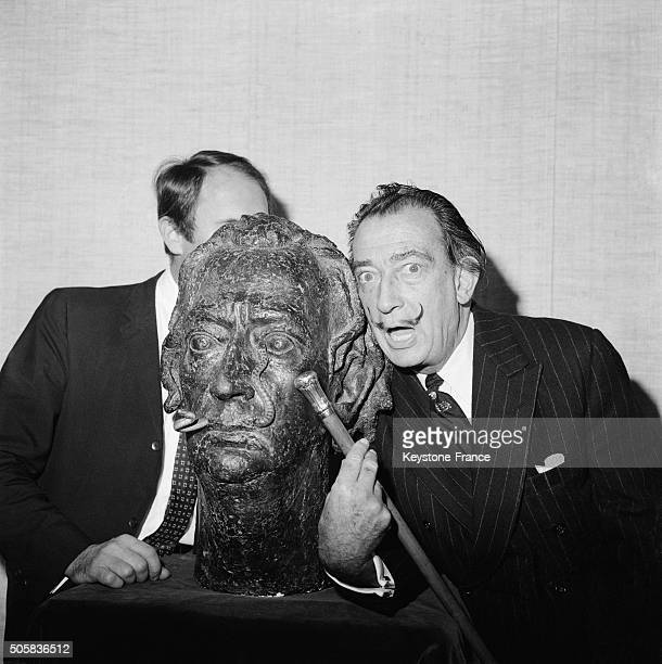 Painter Salvador Dali With His Bust Due To Sculptor Georges Boulogne With Snakes Instead Of Famous Moustaches In A Paris Gallery in Paris France on...