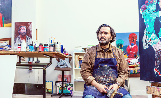 Painter Sitting Front of Easel in Art Sudio 505471322