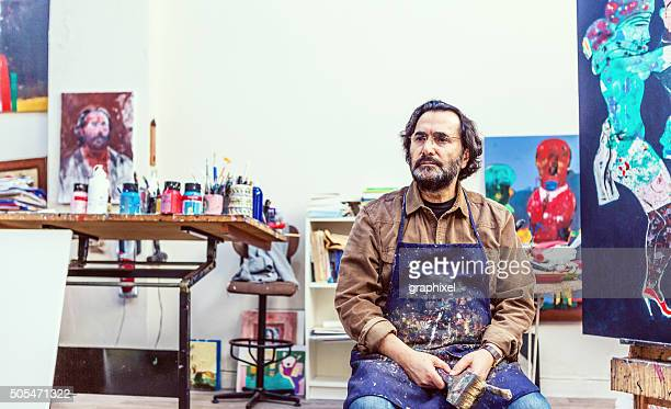 Painter Sitting Front of Easel in Art Sudio